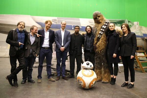 Mark Hamill, director Rian Johnson, Prince Harry, the Duke of Cambridge, actor John Boyega, producer Ram Bergman, Chewbacca, actress Daisy Ridley and producer Kathleen Kennedy pose during a tour of the Star Wars sets at Pinewood studios in Buckinghamshire.