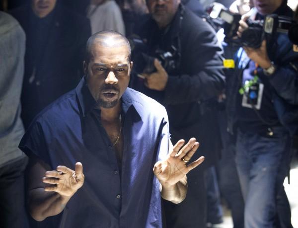 Kanye West with photographers