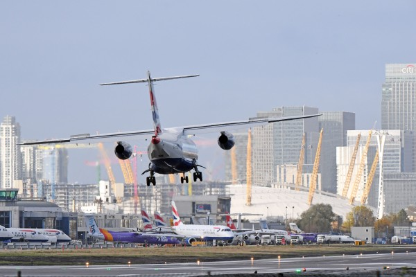 A BA plane battles the winds to land safely at London City Airport (Victoria Jones/PA)