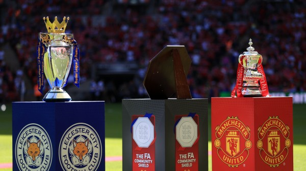 The Premier League trophy and the FA Cup