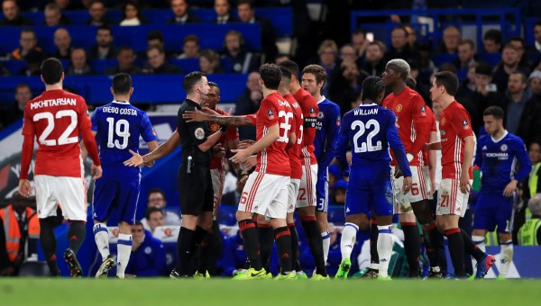 PLayers surround referee
