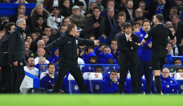 Official hands out between the two managers
