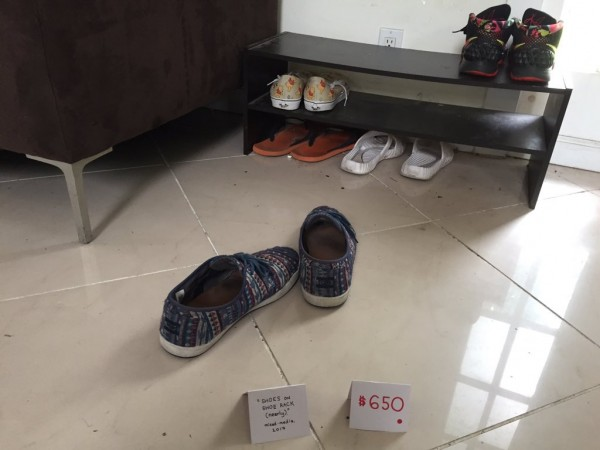 Shoes sat away from a shoe rack, with sarcastic signs