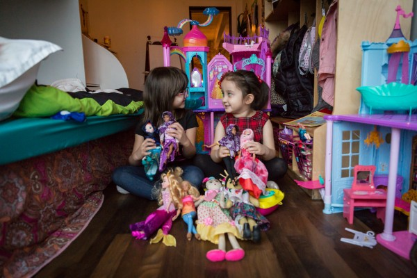 Salma Bokhari, age 5, and Grace Fetterman, also age 5, play with Graces dolls while