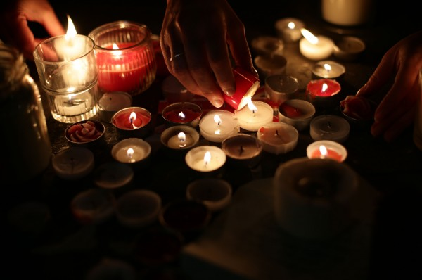 Members of the public light candles during the vigil in Trafalgar Square, London to remember those who lost their lives in the Westminster terrorist attack (Yui Mok/PA).