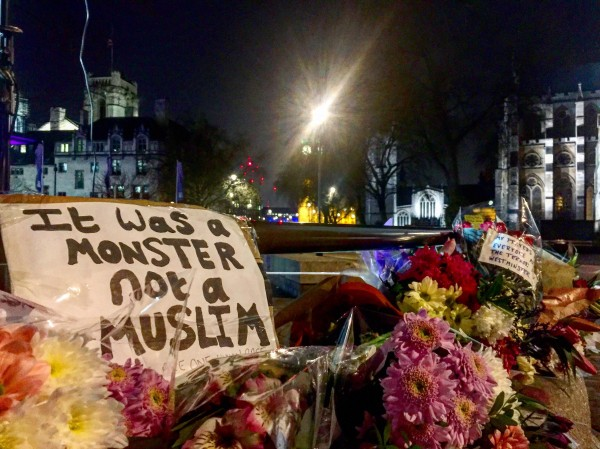Floral tributes are left after the vigil in Trafalgar Square, London to remember those who lost their lives in the Westminster terrorist attack (David Wilcock/PA).