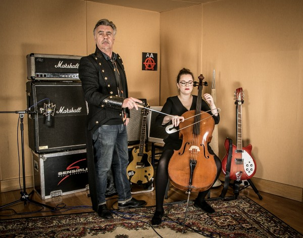 Former Sex Pistols bassist Glen Matlock with cellist Hen Titcombe at the launch of The Anarchy Arias album where the Royal Philharmonic Orchestra collaborated with opera singers to record an album of punk tunes. (Universal Music/Press Association Images)