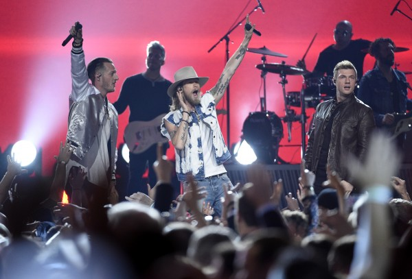 Nick Carter performs with Tyler Hubbard and Brian Kelley, of Florida Georgia Line (Photo by Chris Pizzello/Invision/AP)