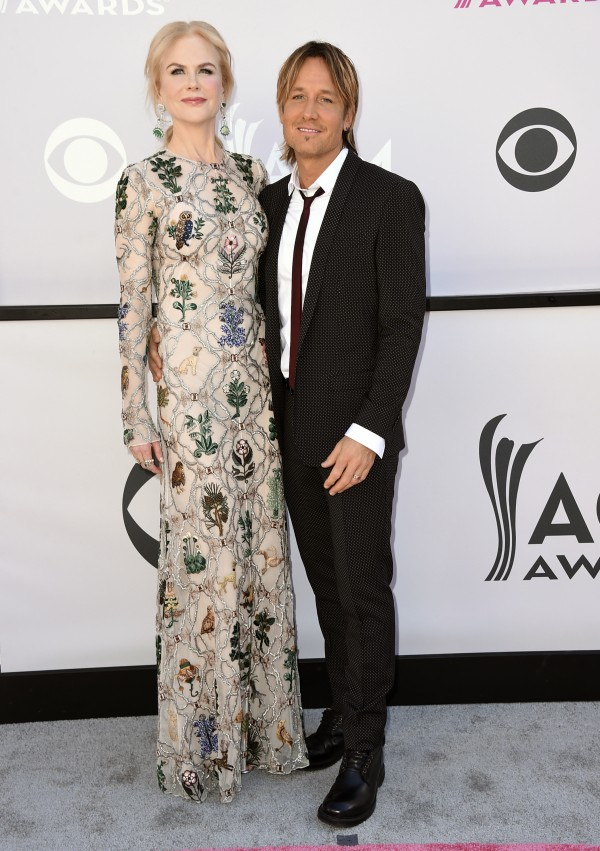 Nicole Kidman, left, and Keith Urban arrive at the awards (Jordan Strauss/Invision/AP)