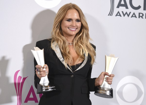 "Miranda Lambert poses in the press room with her awards for album of the year for ""The Weight of These Wings,"" and female vocalist of the year at the 52nd annual Academy of Country Music Awards at the T-Mobile Arena on Sunday, April 2, 2017, in Las Vegas. (Photo by Jordan Strauss/Invision/AP)"