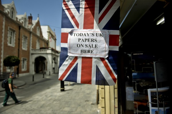 A sign outside a newsagents in Gibraltar, advertising UK newspapers.