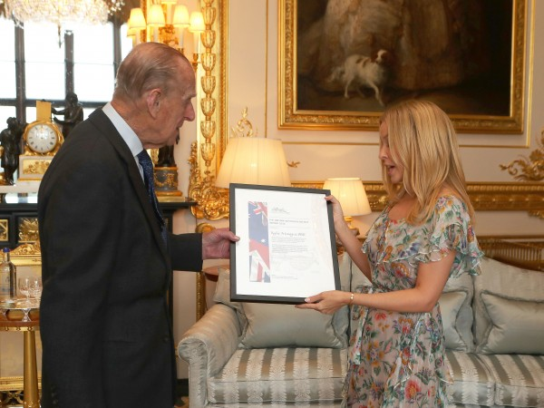 The Duke of Edinburgh, Patron of the Britain-Australia Society, presents Kylie Minogue with the Britain-Australia Society Award for 2016 during a private audience in the White Drawing Room at Windsor Castle, in Berkshire. (Steve Parsons)