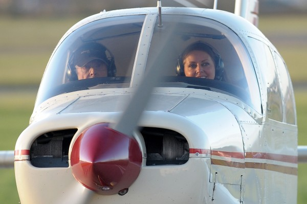 Carol Vorderman with flight examiner Bill Tollett at the Staverton Flying School at Gloucester Airport after passing her private pilot's licence (PPL) test.