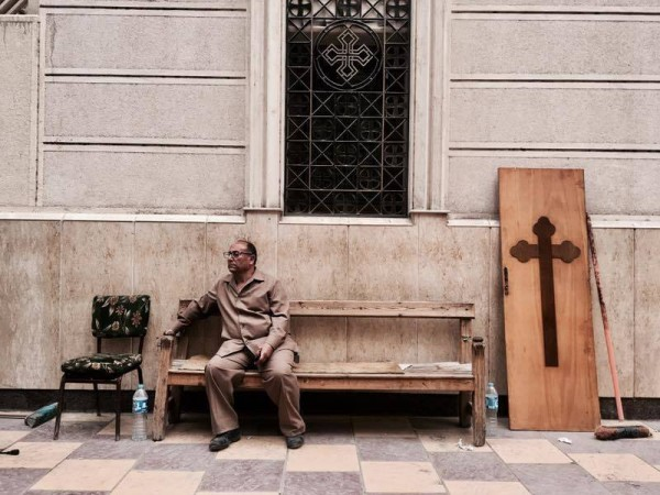 Man sits outside the church