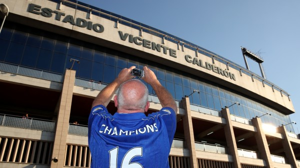 A Leicester City fan takes a photo of the Vicente Calderon