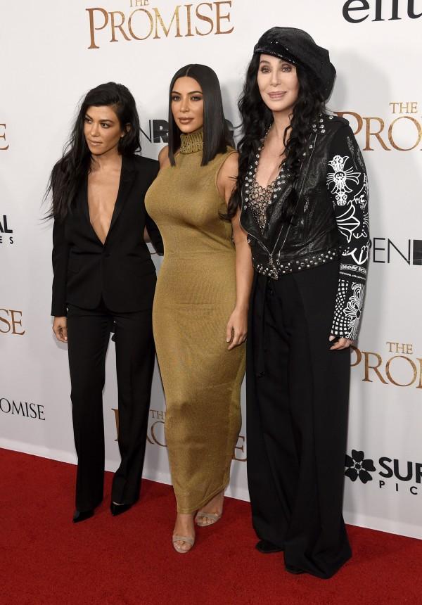 Kourtney Kardashian, Kim Kardashian West and Cher arrive at the US premiere of The Promise