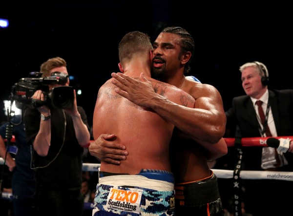 David Haye (right) embraces Tony Bellew after losing the heavyweight contest at The O2.