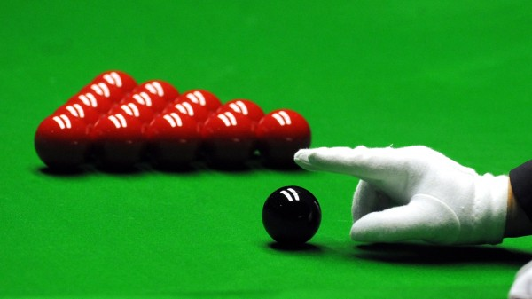 A snooker referee's hand