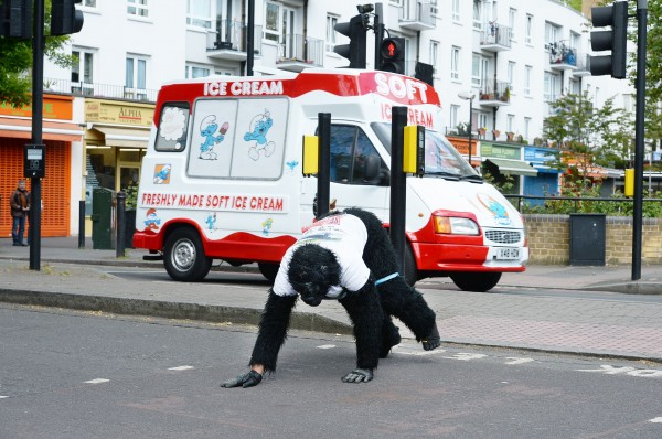 Metropolitan Police officer Tom Harrison, who goes by the name Mr Gorilla, in Bermondsey south east London, as he has been crawling the London Marathon in a gorilla costume since the race began on Sunday morning.