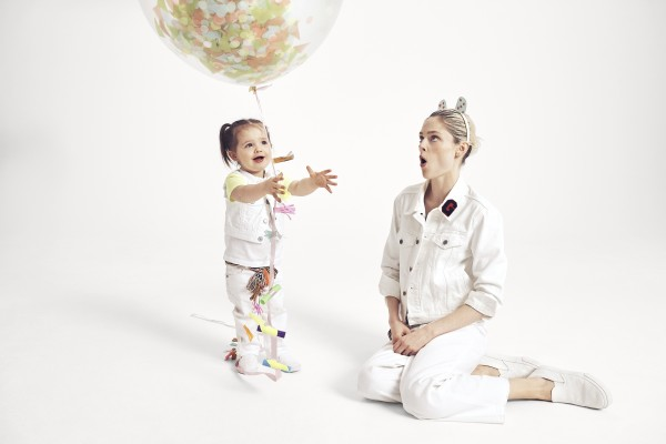 Coco and baby Ioni play around with balloons while filming with Gap.