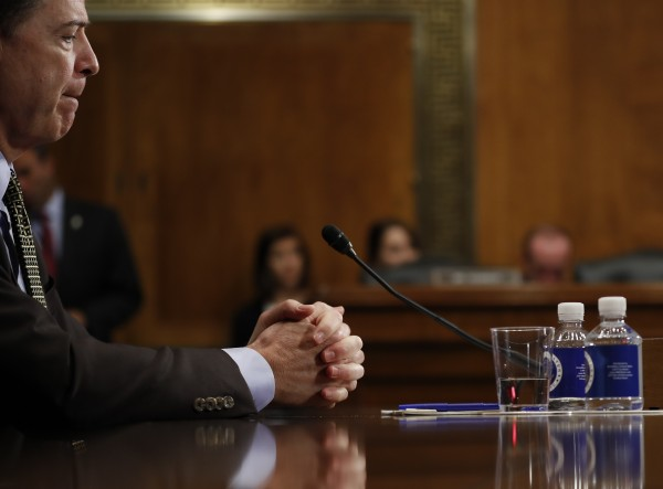 FBI Director James Comey pauses as he testifies on Capitol Hill