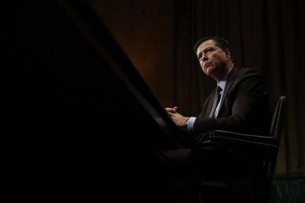 FBI Director James Comey listens while testifying on Capitol Hill