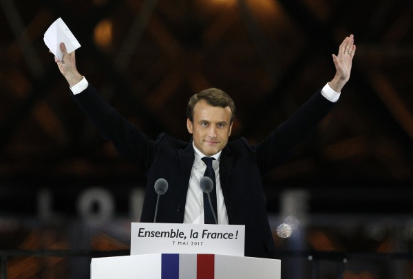 French President-elect Emmanuel Macron gestures during a victory celebration outside the Louvre museum in Paris, France, Sunday, May 7, 2017.