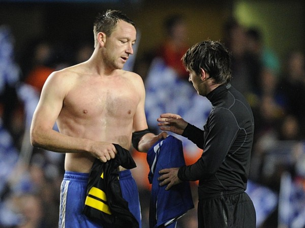 Chelsea's John Terry and Barcelona's Lionel Messi