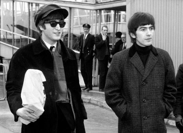 John Lennon (l) and George Harrison (PA)
