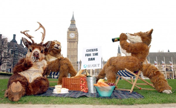 IFAW campaigners Corinne Evans, (r), Helen Nash (left, the stag) and Jenny Hawley (the hare) during a photocall in Parliament Square, to celebrate the Hunting Act.