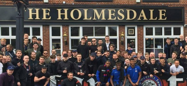 The players with the fans outside the pub