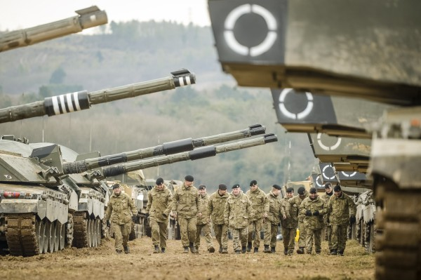 Soldiers from The Royal Tank Regiment walk through rows of Challenger II main Battle Tanks