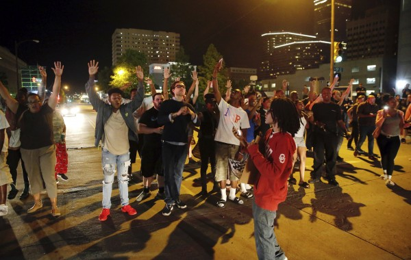 A group of protesters block Denver Avenue near the Tulsa County Courthouse
