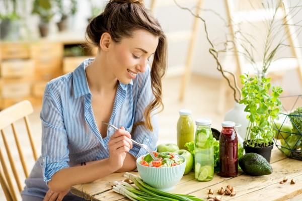 Woman eating salad.