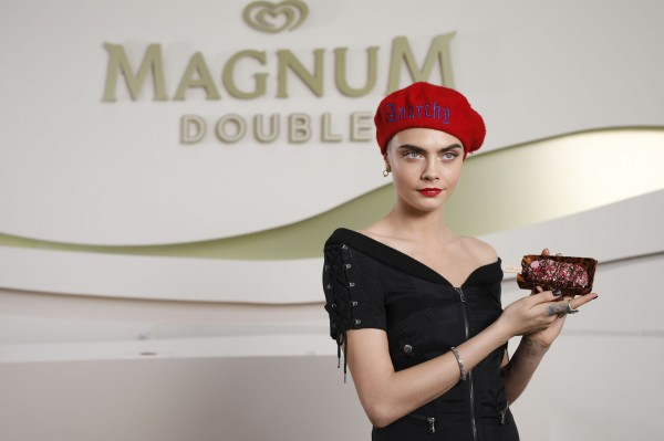 Cara models her own ice cream at Cannes.