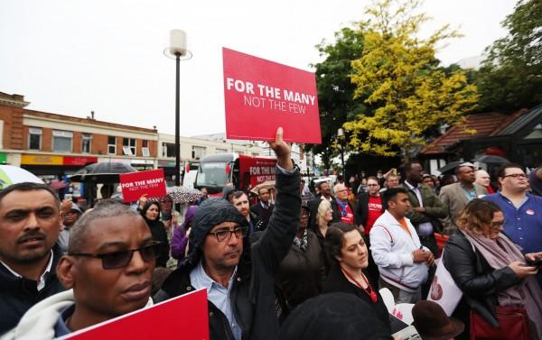 supporters listen to Corbyn (Jonathan Brady/PA)