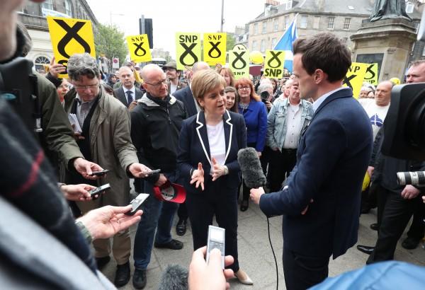 Nicola Sturgeon talks to reporters (Jane Barlow/PA)