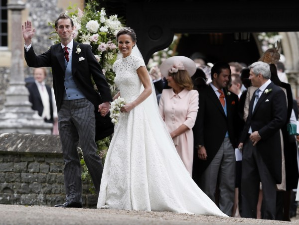 Pippa Middleton and James Matthews smile for the cameras after their wedding at St Mark's Church (Kirsty Wigglesworth/AP)