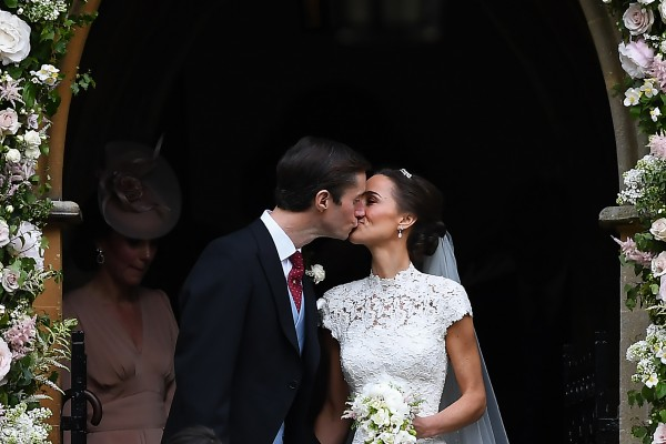 Pippa Middleton and her husband James Matthews kiss