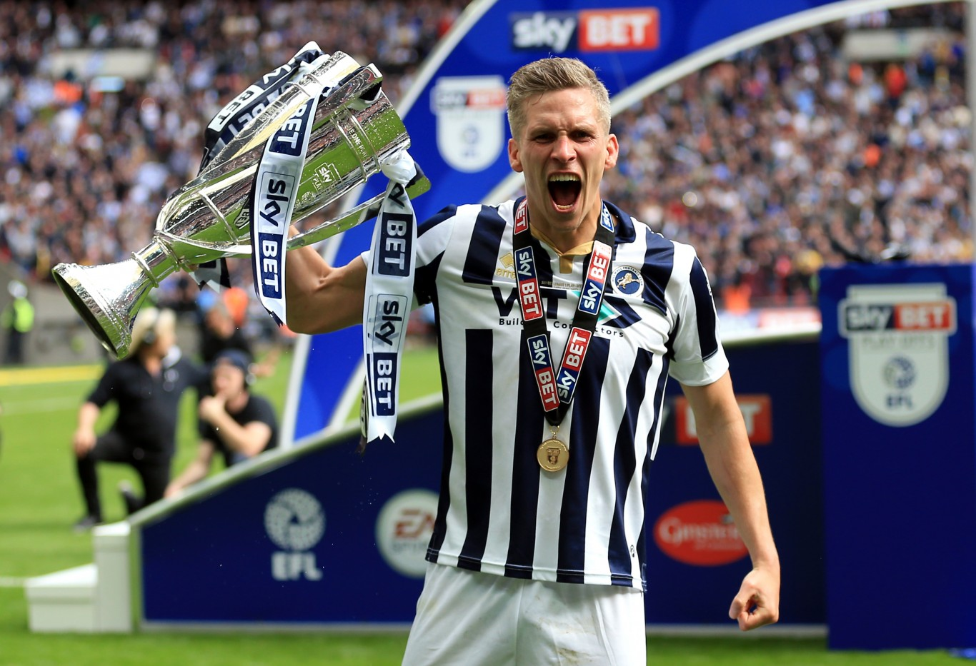 Morison later celebrated with the trophy (Nigel French/PA)