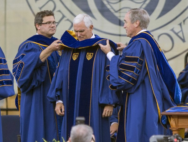 Vice President Mike Pence, centre, receives an honorary degree