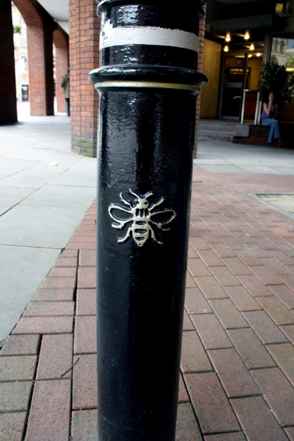 a bee motif on a bollard (Natalia Balcerska Photography/Flickr)