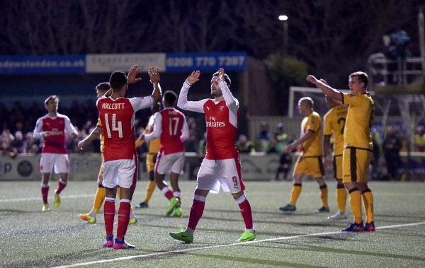 Arsenal's Theo Walcott (left) and celebrates scoring his side's second goal of the game with Lucas Perez