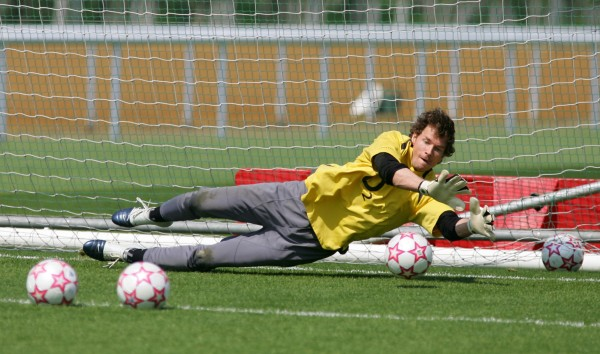 Former Arsenal goalkeeper Jens Lehmann practices saving penalties