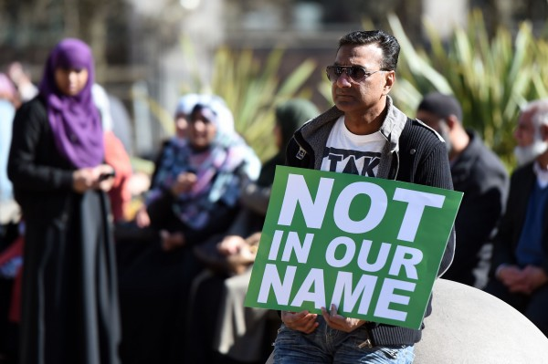 PABEST People take part in a #NotInOurName public rally