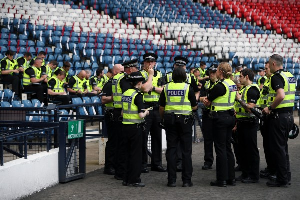 Police are briefed inside the stadium in Glasgow.