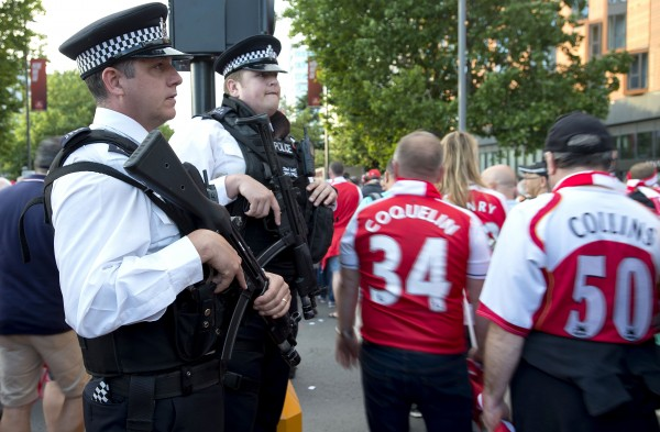 Armed police officers patrol outside Wembley Stadium.