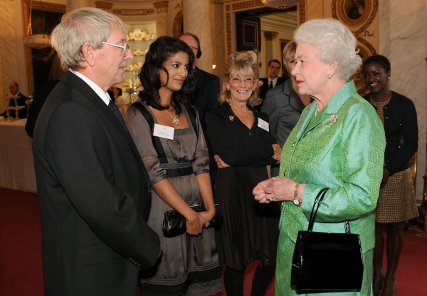 Elizabeth II receiving Blue Peter presenters, (left to right) John Noakes, Konnie Huq, Lesley Judd, and Diane-Louise Jordan, during a reception to mark the programme's 50th birthday (Fiona Hanson/PA)