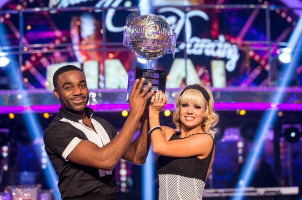 Joanne Clifton and Ore Oduba with the glitterball trophy