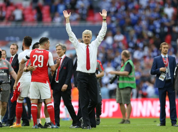 Arsenal's manager Arsene Wenger celebrates winning the FA Cup against Chelsea